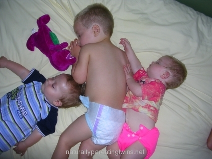 8-month-old-twins-sleeping-with-big-brother.jpg
